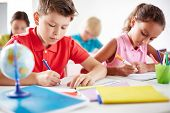 stock photo of pre-adolescents  - Junior pupils drawing with multi - JPG
