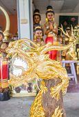 image of handicrafts  - Handicraft golden dragon made of wood stock photo - JPG