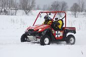 The Quad Bike's Drivers Ride Over Snow Track