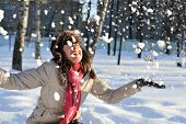 stock photo of ruddy-faced  - funny teenager girl playing in deep snow - JPG