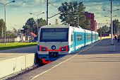 foto of railcar  - Modern suburban electric train standing at the station photo with toned effect - JPG