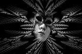foto of divergent  - Surreal carnival mask and fractal pattern of the leaves as divergent rays - JPG