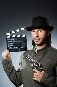 picture of top-gun  - Man with gun and movie clapboard - JPG
