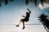 Teenage Jumping On Slackline poster