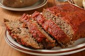 picture of meatloaf  - Meatloaf with tomato paste on a serving plate - JPG