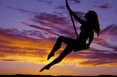 picture of swing  - A silhouette of a woman swinging on her swing - JPG