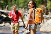 picture of wet feet  - Hiking friends having fun crossing river in forest - JPG