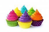 stock photo of cupcakes  - Colorful cupcakes against a white background - JPG