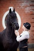 stock photo of horse girl  - Portrait of the girl and black horse - JPG