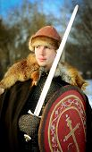 stock photo of reconstruction  - young man historical reconstruction warrior of ancient Russia - JPG