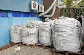 image of raw materials  - Raw bulk material in sacks at pallets - JPG
