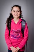 stock photo of pre-adolescent girl  - Young school girl with gray backpack - JPG