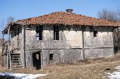 foto of animal husbandry  - Old abandoned outbuilding for rearing animals in mountains - JPG