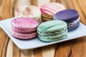 pic of flavor  - french macaroons on a white plate in a variety of colors an d flavors  - JPG