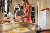 image of morning  - Indoor shot of happy young couple standing at the kitchen counter in morning - JPG