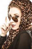 stock photo of leopard  - Young woman with leopard pattern scarf and sunglasses - JPG