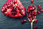 picture of pomegranate  - Pieces and grains of ripe pomegranate - JPG