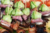 image of chopsticks  - fish and meat snack with vegetables on chopsticks - JPG