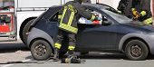 foto of firefighter  - brave Firefighters freed the wounded by car accident sheet - JPG
