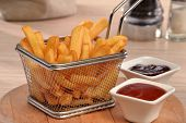 stock photo of dipping  - Fried potatoes chest and sauces dip - JPG