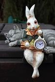 stock photo of hare  - Vintage clock in hands at a fantastic hare - JPG