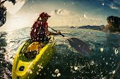 picture of paddling  - Young lady paddling the kayak in the sea with lots of splash - JPG