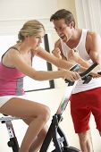 image of exercise bike  - Young Woman On Exercise Bike With Trainer - JPG