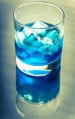 foto of curacao  - Glass Of Blue Curacao Cocktail Close Up - JPG