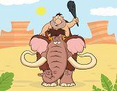 stock photo of mammoth  - Happy Caveman Over Mammoth - JPG