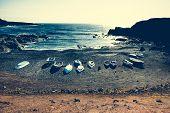 pic of tide  - boats on a sandy stony tide - JPG
