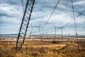 image of power transmission lines  - scenic landscape of fields with power transmission lines - JPG