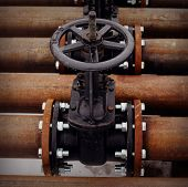 image of valves  - Oil and gas pipeline valves on a rusty piping - JPG