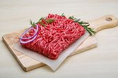 stock photo of veal meat  - Raw beef minced meat with rosemary and onion - JPG