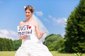 picture of married  - Wedding bride standing hitchhike at street with  - JPG
