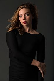 picture of tight dress  - Beautiful young brunette in a tight black dress - JPG