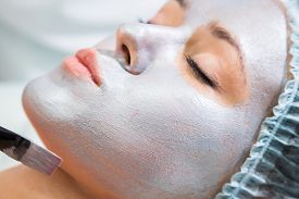 pic of face mask  - Application of rejuvenating mask on the face of the girl - JPG