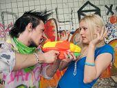 stock photo of scumbag  - scum boy robbing sexy girl - JPG