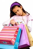 stock photo of spoiled brat  - a girl getting impatient after doing her shopping - JPG