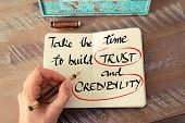 Text Take The Time To Build Trust And Credibility poster