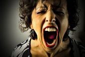 stock photo of outrageous  - closeup of woman screaming - JPG