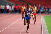 KUALA LUMPUR - AUGUST 15: Thailand's visually impaired athlete wins the 800m race at the track and f