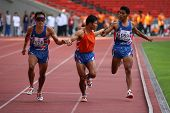 KUALA LUMPUR - AUGUST 18: Thailand's visually impaired relay team in action at the track and field e