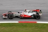KUALA LUMPUR - APRIL 4: McLaren Mercedes driver Jenson Button takes the hairpin turn on race day at