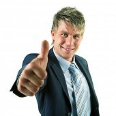 picture of thumbs-up  - A businessman in a suit giving the thumbs - JPG