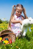 stock photo of easter bunnies  - Child hunting the Easter bunny on a spring meadow - JPG