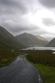picture of long winding road  - long and winding road in ireland traveling along a river - JPG