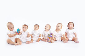 stock photo of twin baby  - Group of babies sitting on white studio background - JPG