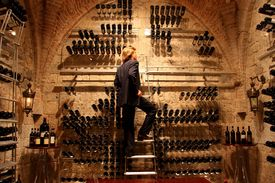 stock photo of wine cellar  - a man in a wine cellar - JPG