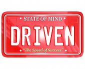 stock photo of diligent  - A red license plate with the word Driven - JPG