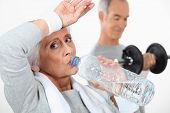 foto of transpiration  - Elderly couple working out together - JPG